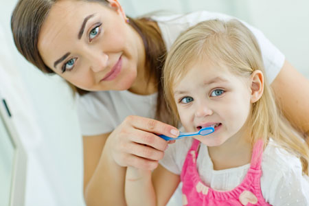 Mom and Daughter brushing their teeth - Pediatric Dentist in Tracy, CA